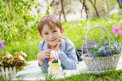 Boy lying among Easter decor Royalty Free Stock Images