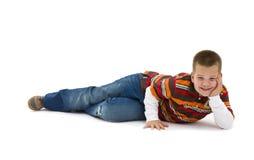 Boy lying on floor Stock Photo