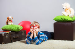 Boy lying on the floor Royalty Free Stock Photo