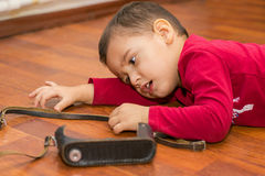 Boy  lying on the floor Stock Images