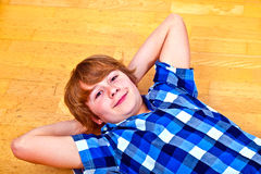 Boy lying at the floor Stock Photo