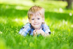 Boy lying in grass Royalty Free Stock Photography