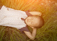 Boy lying on the grass in sunset Royalty Free Stock Photo
