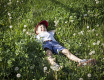 Boy lying on the grass Royalty Free Stock Images