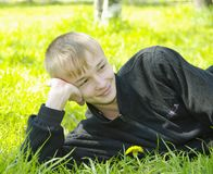Boy lying on green Stock Photo