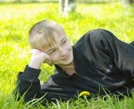 Boy lying on green Stock Photo