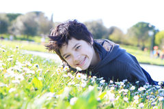 boy lying on green grass Royalty Free Stock Photography