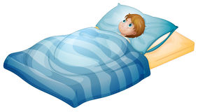 A boy lying in his bed Royalty Free Stock Image