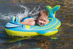 Boy lying on an inflatable rubber mattress on the sea. Six-year-old boy lying on an inflatable rubber mattress on the sea stock photos