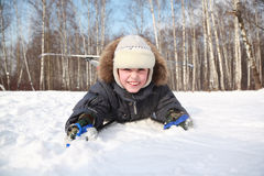 Boy lying inside winter forest Royalty Free Stock Photography