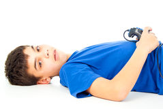Boy lying with a joystick Stock Photo