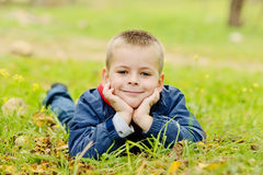 Boy lying on the meadow Royalty Free Stock Images