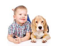 Boy is lying near a puppy. isolated on white background Royalty Free Stock Photos