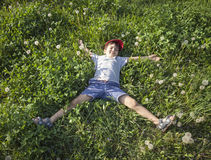 Boy Lying On The Grass Stock Image