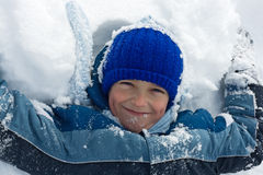 Boy lying in snow Royalty Free Stock Image