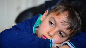 Boy lying on sofa and watching tv stock video