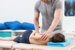 Boy lying on treatment table Stock Photos