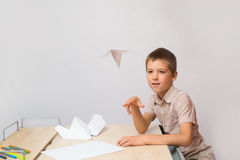 The boy made a paper plane and ran it Stock Photos