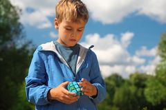Boy with magic cube outdoor Stock Image