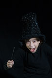Boy with magic wand Stock Photo