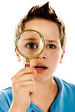 Boy with magnifier Royalty Free Stock Image