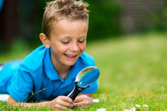 Boy with magnifier Stock Photo