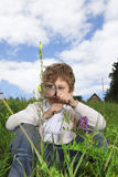 Boy with magnifying glass Stock Image