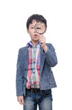 Boy with magnifying glass over white Stock Photography