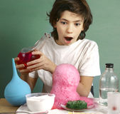 Boy make chemical experiments with reagent Stock Images