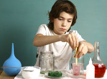 Boy make chemical experiments with reagent Stock Photos