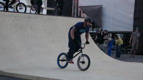 Boy make extreme jumps on BMX bicycle in skate park, then fall down. stock video footage