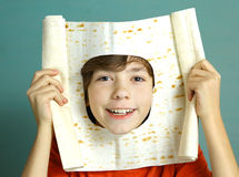 Boy make fun cut hole in pita thin bread Stock Image