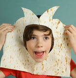 Boy make fun show baffoon from pita bread Stock Images