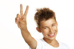 Boy make victory sign Stock Photos