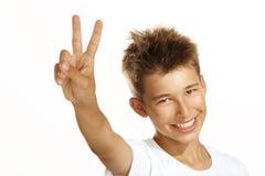 Boy make victory sign Stock Photos