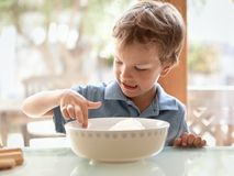 Boy makes a cake in kitchen Stock Image