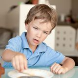 Boy makes a cake in kitchen Stock Photo