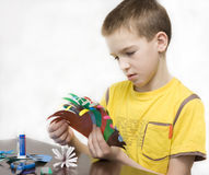 The boy makes crafts. royalty free stock image
