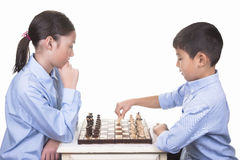 Boy makes the first chess move. Royalty Free Stock Photo
