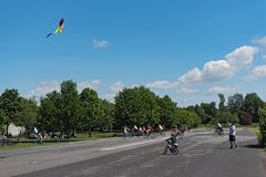 Boy makes a kite climb on the nature and recreation area. Old airfield in Frankfurt-Bonames.  Royalty Free Stock Photo
