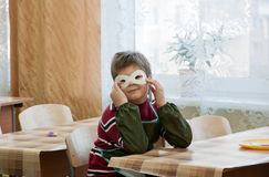 Boy makes a masquerade mask in class at school Stock Photography