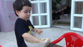 Boy makes Matzah brei stock footage
