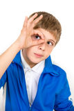 Boy makes okey sign. Boy makes interested faces and okey sign Stock Images