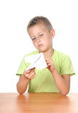 Boy makes paper plane Royalty Free Stock Photos