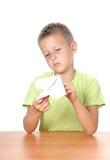 Boy makes paper plane Royalty Free Stock Photos