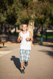 Boy makes a run Stock Photography