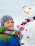 Boy makes a snowman Royalty Free Stock Photos