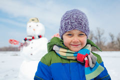 Boy makes a snowman Royalty Free Stock Images