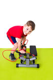 Boy makes sports Royalty Free Stock Photography