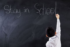 Boy makes text of Stay in School Stock Image